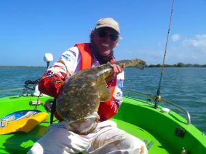 john with his 94.5cm flathead we caught during the flathead classic 2014 which won longest flathead on a hard body lure. it was taken in tipplers passage
